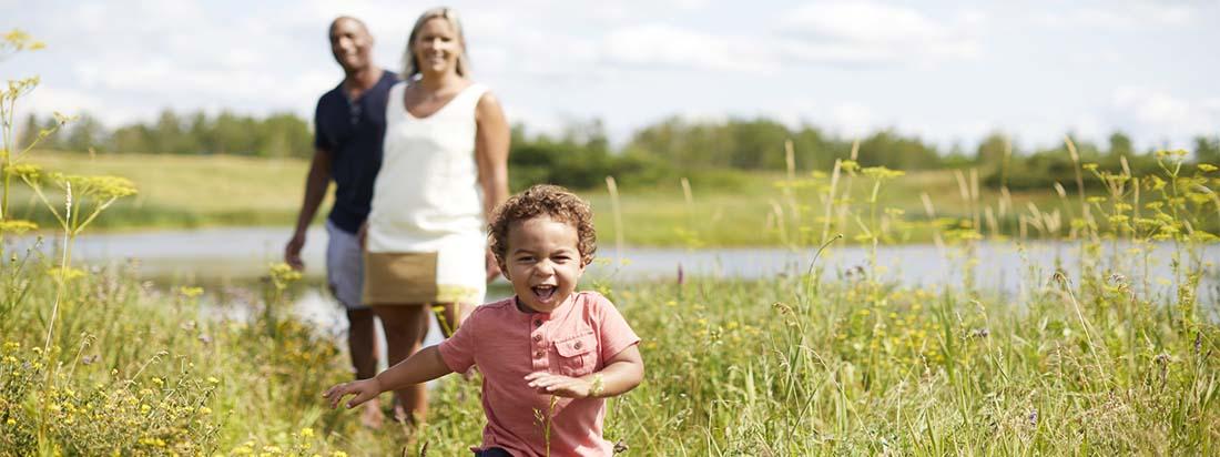 Family walking near Avalon Aquaview Pond