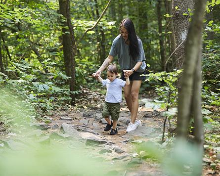 Mom walking with son outside in Arcadia Kanata