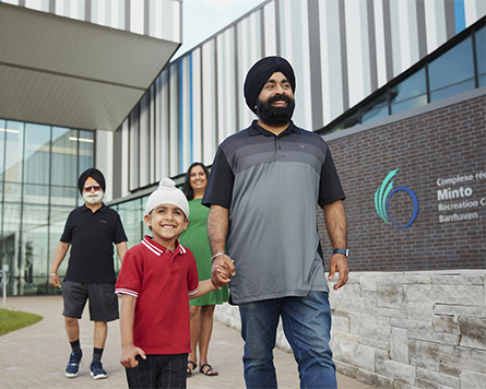 Family outside Minto Recreation Centre in Harmony Barrhaven